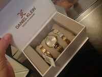 gold-colored analog watch with box 533 km