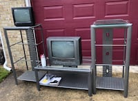TV entertainment center - metal gray with glass shelves- like new, never used. Hides all cables/wires Virginia Beach, 23464