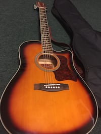 Red and white acoustic guitar with gig bag Columbus, 31901