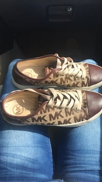 Pair of brown-and-white low top sneakers Raleigh, 27604