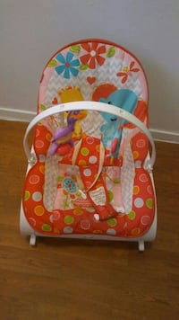 baby's white and red polka-dot bouncer