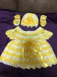 baby's yellow and white knitted dress