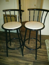 two black metal framed beige padded bar stools Las Vegas, 89103