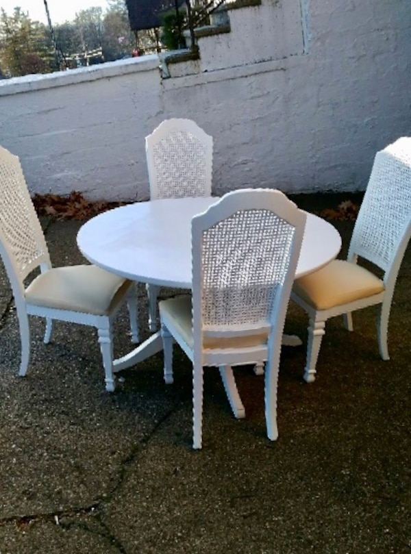 Solid wood pedestal table with four chairs