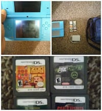 teal Nintendo DS portable game console with game cartridges