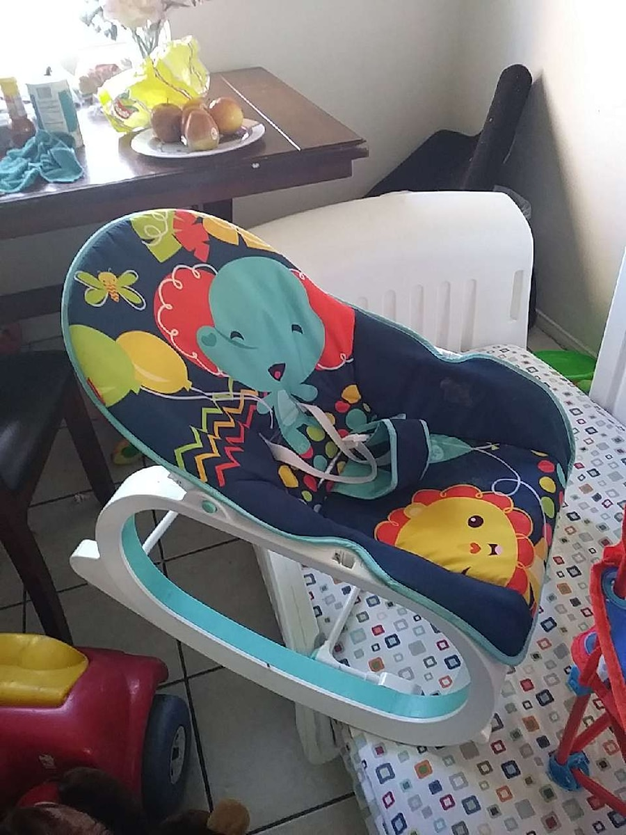 baby's blue and red bouncer seat