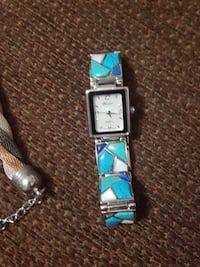 rectangular analog blue and silver watch