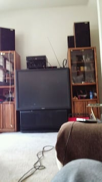 black flat screen TV with brown wooden TV hutch Denver, 80229