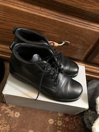 Brand new pair of black leather shoes