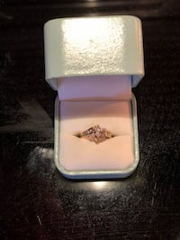 Brand new Gold and diamond ring in box