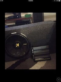 Black and grey kicker audio amplifier and subwoofer speaker