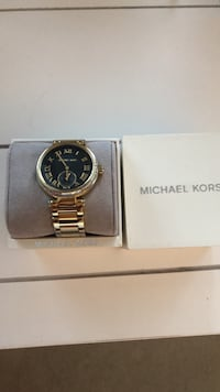 mK woman's watch gold with black face very elegant and classy  Surrey, V4N 6L7