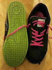 pair of black-and-pink DC skateshoes