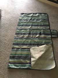Great Condition Picnic Mat. 6 feet by 6 feet when fully opened. Can be easily closed for storage and travel. Check pics on how small it becomes after folding. Easy to clean. Sidney, 45365