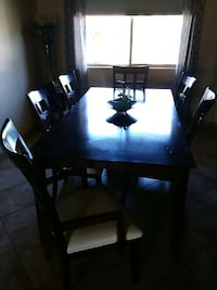 seven-piece black wooden dining set