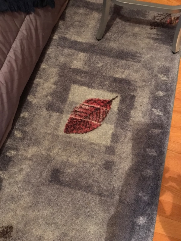 black,gray,and red printed floor rug e3c0fe4f-c8c9-41f0-8375-852f09eb55ff