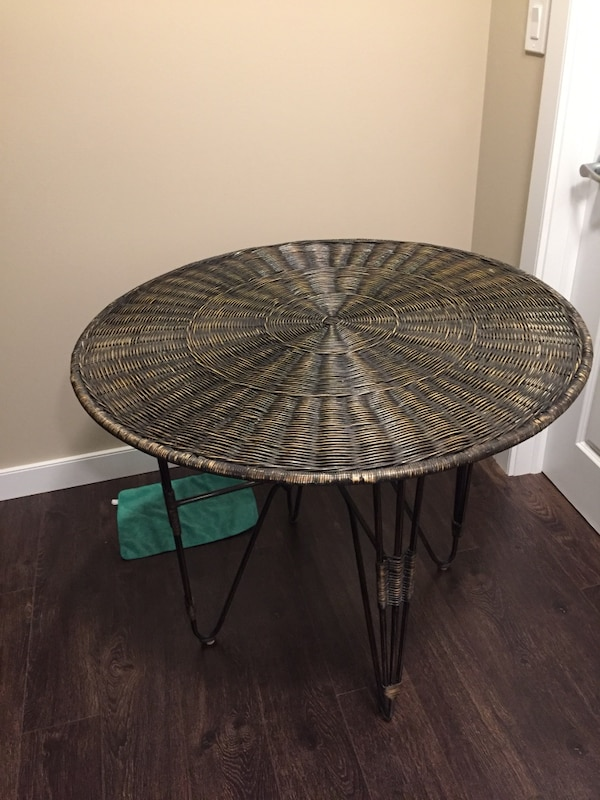 Table and 4chairs. Mint condition. Complete with 4black seat cushions. Unit can be used indoors or outdoors. 4ft diameter smoke glass top. Chairs are made of wrought iron metal. Worth over $1000.00