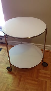 Glass and brass 2 tier round table on wheels Mississauga, L5J 1V6