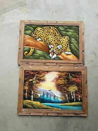 two brown wooden framed photo of animal and body o