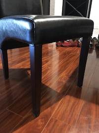 4 black leather padded dining chair and table