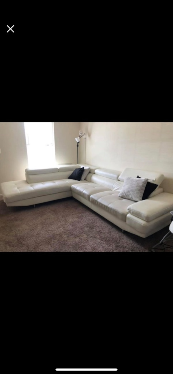 White Leather Sectional cb7961db-8212-4e6f-be4e-05455bab8af3