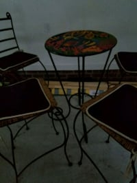 Round fish metal table with 4 chairs Goldsboro, 27530