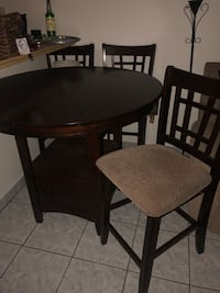 round brown wooden table with two chairs Pomona, 91767