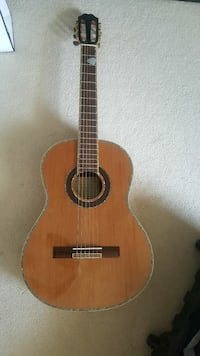 Brown acoustic guitar with case and beginner book  Walnut Creek