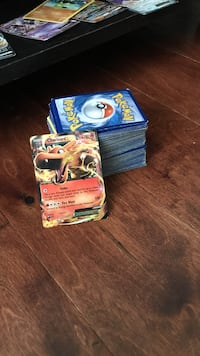 Two assorted pokemon trading cards Sterling, 20165