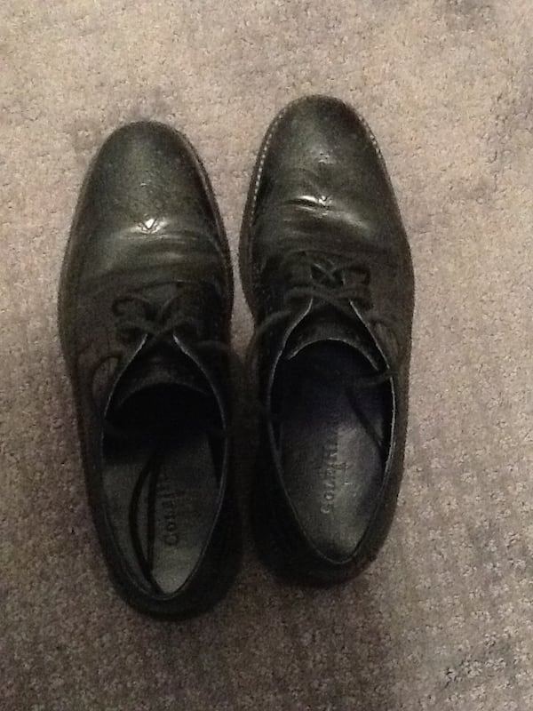 Pair of black leather oxford wingtip dress shoes 4f658bf1-810d-44de-afa5-aeaf1e7a89fb