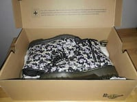 pair of black-and-purple Dr. Martens airwair boots with box