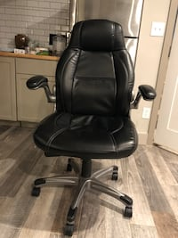black leather office rolling chair