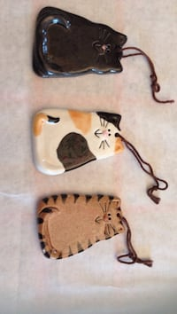 Handmade ceramic cat ornaments