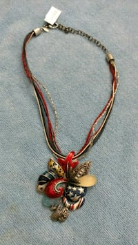 gold-colored necklace with red gemstone pendant 542 mi