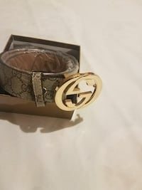 brown and white Gucci belt