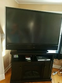 black flat screen TV with black wooden TV stand 234 mi