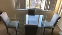 Glass Table with Silver/ light gray chairs Bladensburg, 20710