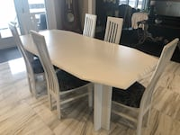 Rectangular white wooden table with six chairs. Table can be made smaller or larger. 530 km