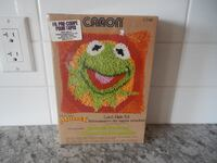"""*Vintage* Muppets """"Kermit the Frog"""" *New in Package* Latch Hook Kit. 15"""" x 15"""", Kit does not come with a latch hook. $25 PU Morinville Morinville"""