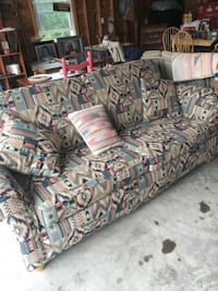 gray and brown floral fabric 3-seat sofa null