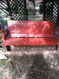 red and brown wooden bench