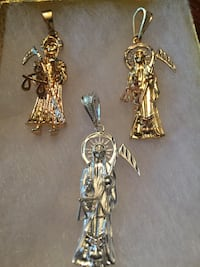 three gold-and-silver-colored pendants Harker Heights