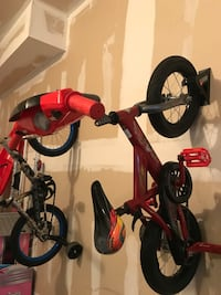 Toddler's red and black bicycle with training wheels 534 km