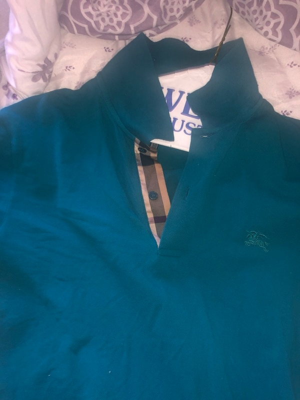 burberry polos size MED all buttons work no rips tears or nothing  6e520afe-305e-480f-a1bc-afbecf0e213a