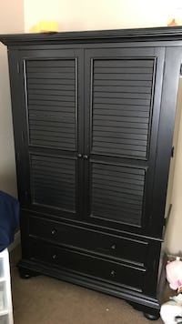 Black wooden armoire