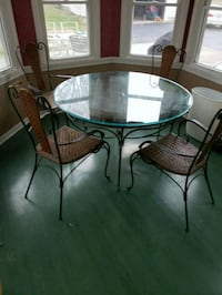 round glass-top table with four chairs 445 mi
