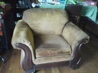 brown wooden framed brown fabric padded armchair New Orleans, 70122