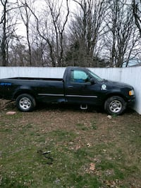 blue Ford F-150 single cab longbed pickup truck Brentwood, 11717