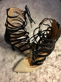 pair of black-and-brown leather gladiator sandals