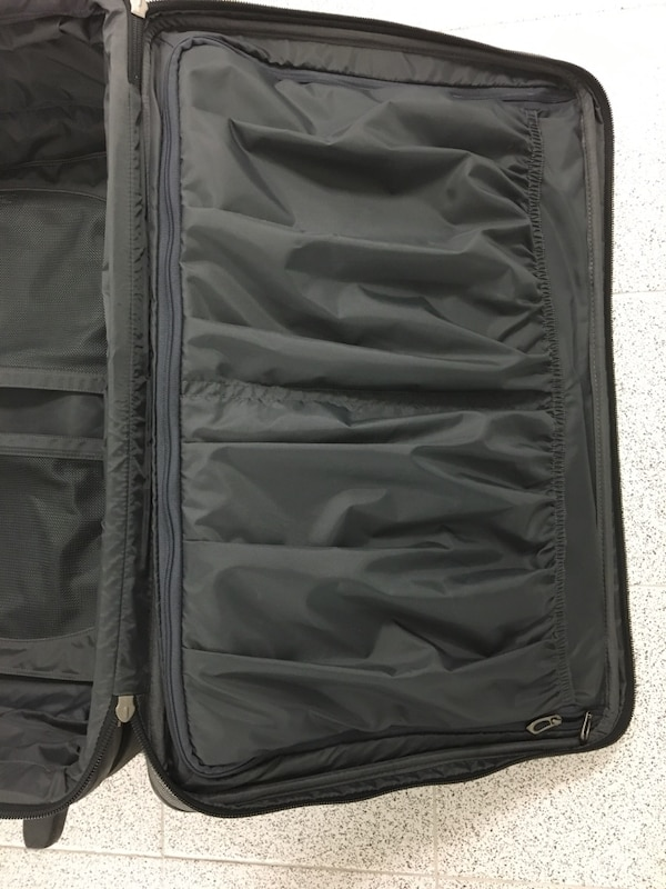 Delsey Rolling Suitcase Luggage 19a34cdc-769f-4815-9bf9-72fe9a5ad5f1